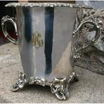 Champagne bucket in silvered metal decoration of vineyards and grapes