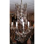 Silvery bronze chandelier and crystal plaques in 9 lights style Louis XV period the end of XIX