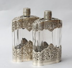 Pair of glass and silver bottles XXth