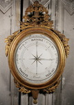 Barometer in gilded and carved wood, Louis XVI period