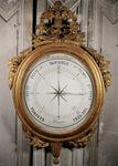 Baromètre en bois doré et sculpté d'époque Louis XVI