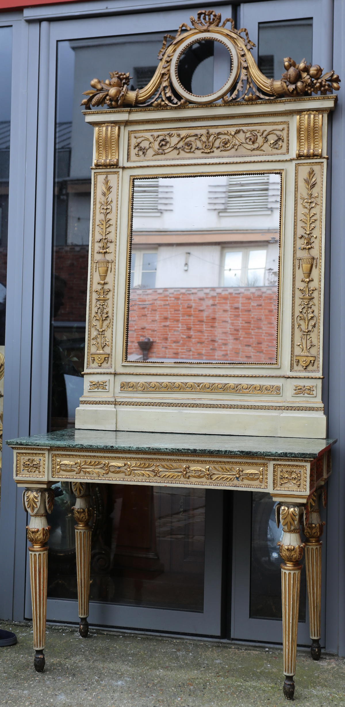 Italy late 18th century, console and mirror.